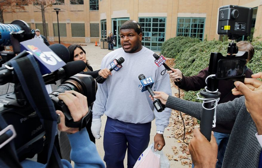 Dallas Cowboys nose tackle Joshua Brent talks to the media after his release from the Irving City Jail after posting a $500,000 bond on Dec. 9, 2012. Brent is charged with intoxication manslaughter after a crash earlier that morning resulted in the death of his passenger, teammate Jerry Brown. (Associated Press/Dallas Morning News)