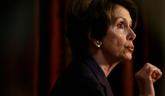 **FILE** House Minority Leader Nancy Pelosi, California Democrat, speaks to reporters at Statuary Hall on Capitol Hill in Washington on Dec. 7, 2012. (Associated Press)