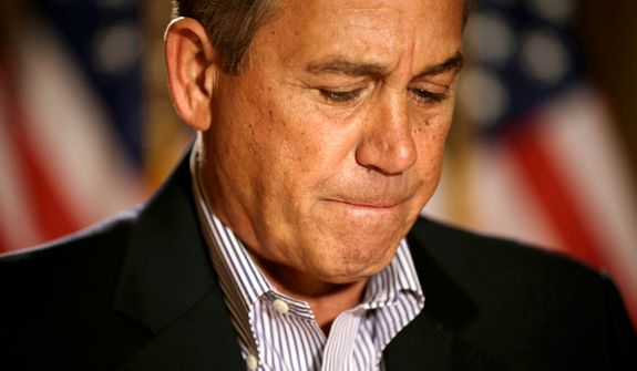 """**FILE** House Speaker John Boehner, Ohio Republican, pauses Dec. 7, 2012, during a news conference on Capitol Hill in Washington to discuss the pending """"fiscal cliff."""" (Associated Press)"""