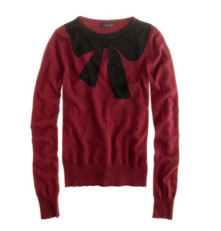 "This undated publicity photo provided by J.Crew shows a crewneck sweater decorated with an oversized bow motif at the neckline by J.Crew. The good, the bad, the kitschy. A ""seasonal sweater"" is one way to start a conversation at a holiday function. (AP Photo/J.Crew)"