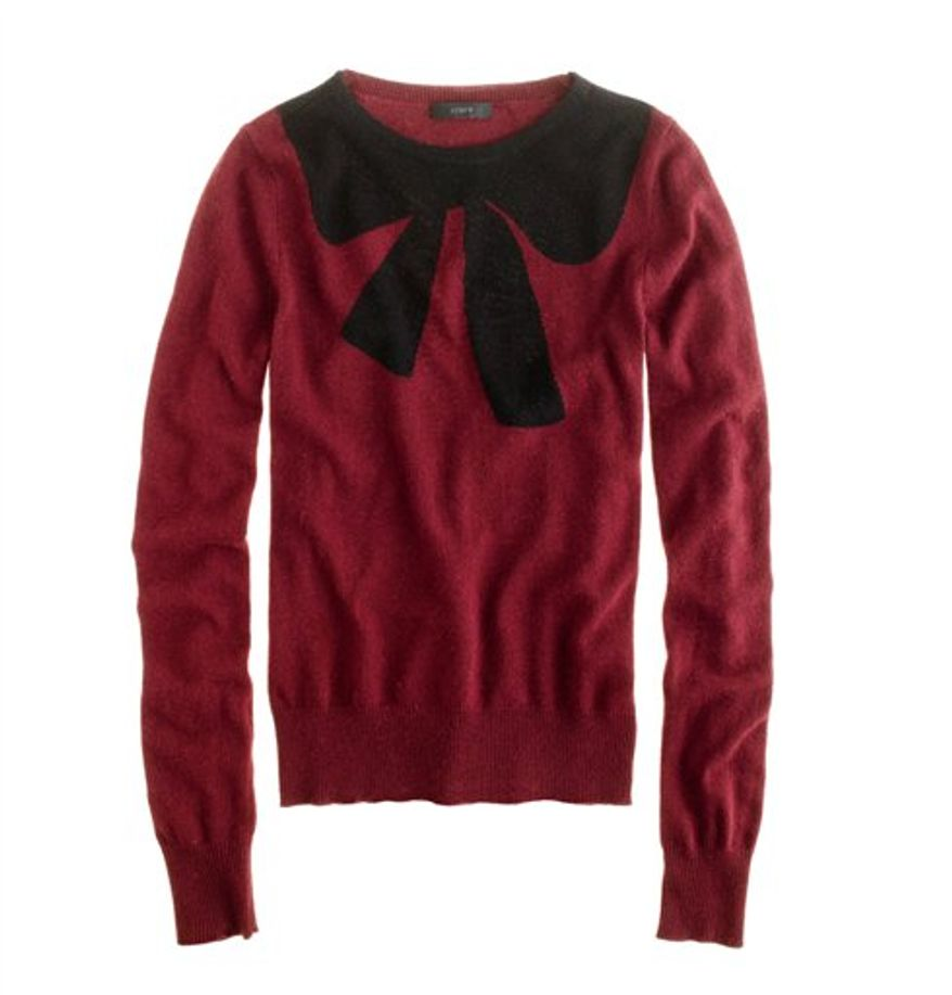"""This undated publicity photo provided by J.Crew shows a crewneck sweater decorated with an oversized bow motif at the neckline by J.Crew. The good, the bad, the kitschy. A """"seasonal sweater"""" is one way to start a conversation at a holiday function. (AP Photo/J.Crew)"""