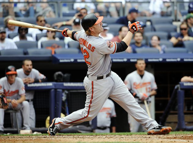 FILE - In this Sept. 2, 2012, file photo, Baltimore Orioles' Mark Reynolds hits a three-run home run during a baseball game against the New York Yankees in New York. A person familiar with the negotiations said on Sunday, Dec. 9, 2012, that the Cleveland Indians have agreed to a one-year contract with free-agent slugger Mark Reynolds. The person spoke on condition of anonymity because the agreement is pending a physical. (AP Photo/Kathy Kmonicek, File)