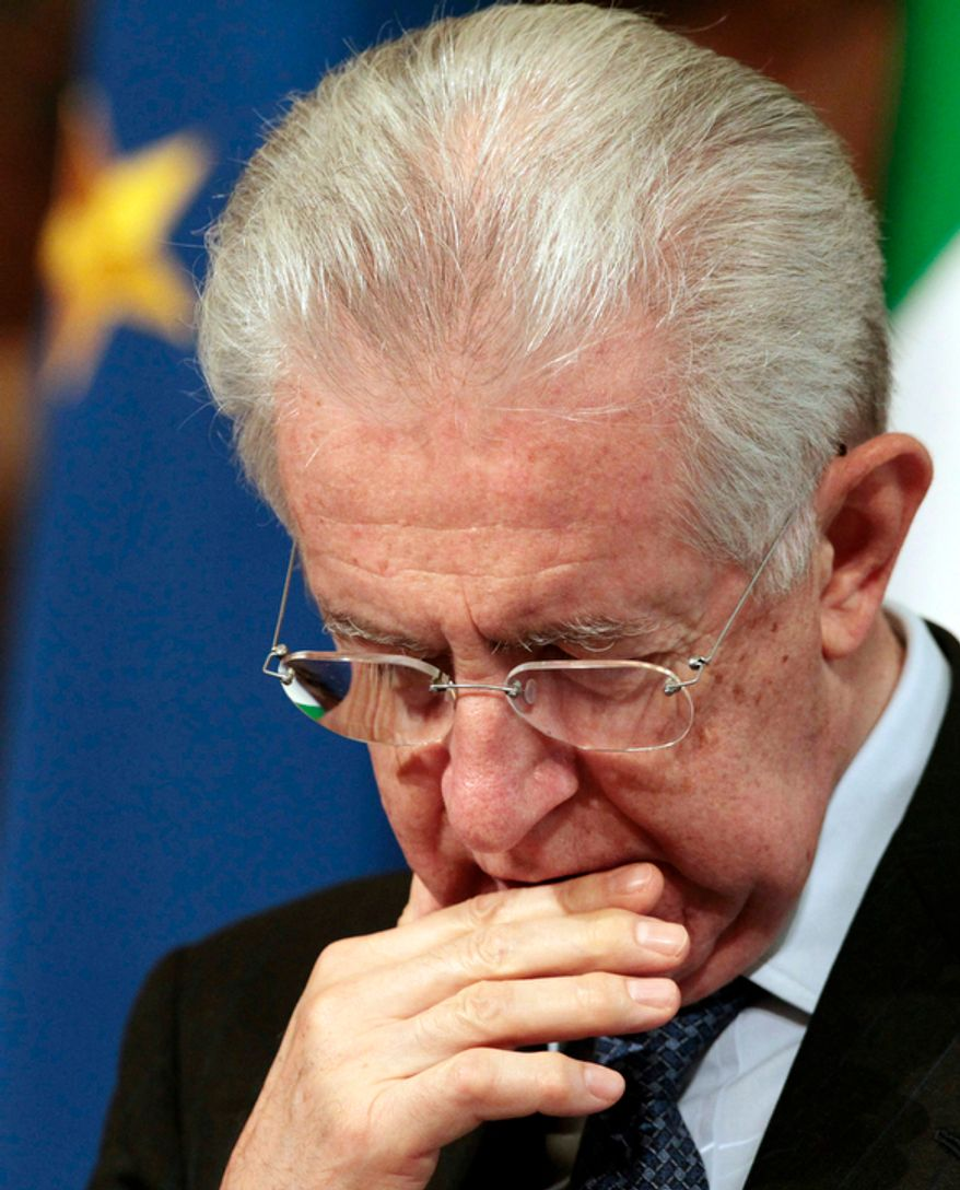 **FILE** Italian premier Mario Monti looks down Oct. 24, 2012, during a joint press conference with Austrian chancellor Werner Faymann at Chigi palace at the Premier's office in Rome on Oct. 24, 2012. (Associated Press)