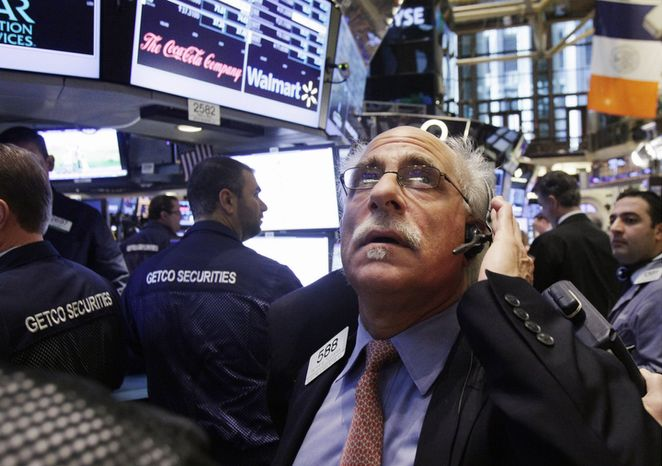 **FILE** Trader Peter Tuchman works on the floor of the New York Stock Exchange in New York on Dec. 6, 2012. (Associated Press)