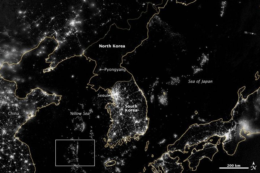 """**FILE** The Korean Peninsula is seen Sept. 24, 2012, at night from a composite assembled from data acquired by the Suomi NPP satellite. The image was made possible by the new satellite's """"day-night band"""" of the Visible Infrared Imaging Radiometer Suite (VIIRS), which detects light in a range of wavelengths from green to near-infrared and uses filtering techniques to observe dim signals such as city lights, gas flares, auroras, wildfires, and reflected moonlight. City lights at night are a fairly reliable indicator of where people live. But this isn't always the case, and the Korean Peninsula shows why. (Associated Press/NASA)"""