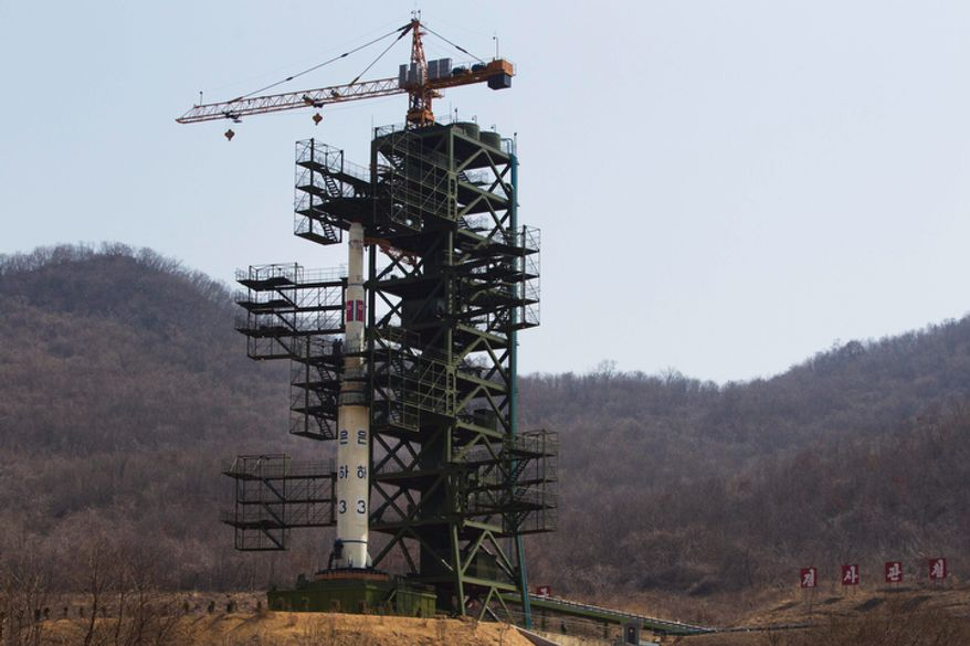 **FILE** North Korea's Unha-3 rocket stands April 8, 2012, at Sohae Satellite Station in Tongchang-ri, North Korea. (Associated Press/David Guttenfelder, File)