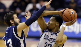Longwood guard David Robinson (13) guards Georgetown forward Otto Porter Jr.,(22) during the second half of an NCAA college basketball game, Monday, Dec. 10, 2012, in Washington. Georgetown won 89-53. (AP Photo/Alex Brandon)