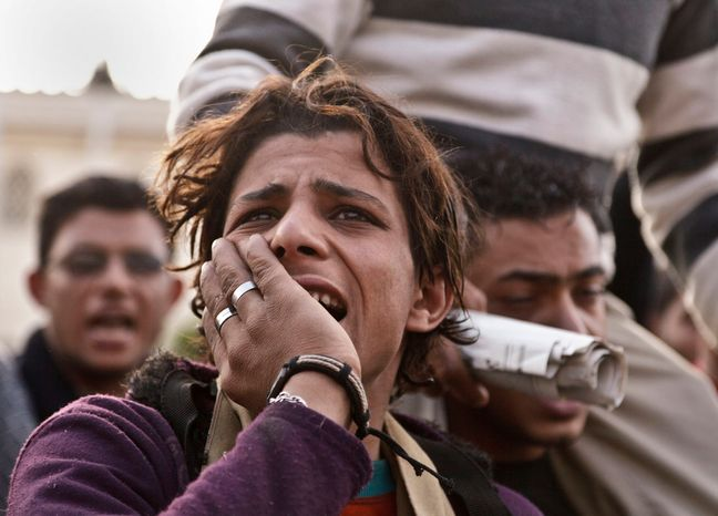 "A protester opposed to Egyptian President Mohammed Morsi chants slogans outside the presidential palace in Cairo on Dec. 8, 2012. Egypt's military said that serious dialogue is the ""best and only"" way to overcome the nation's deepening conflict over a disputed draft constitution. (Associated Press)"
