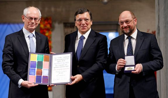 European Council President Herman Van Rompuy (left), European Commission President Jose Manuel Barroso (center) and European Parliament President Martin Schulz stand with the Nobel diploma on the podium at the City Hall in Oslo during the Nobel Peace Prize ceremony on Dec. 10, 2012. (Associated Press/Cornelius Poppe/NTB Scanpix)