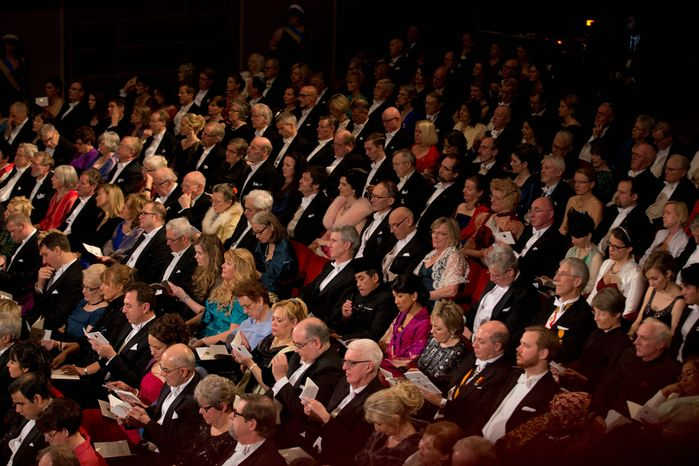 The audience listen during the Nobel Prize award ceremony at the Stockholm Concert Hall in Stockholm on Dec. 10, 2012. The Nobel awards are always awarded on Dec. 10, the anniversary of Alfred Nobel's death in 1896. (Associated Press)