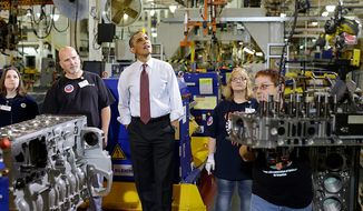 President Obama watches workers during a Dec. 10, 2012, visit to the heavy duty engines line at the Daimler Detroit Diesel plant in Redford, Mich. (Associated Press)