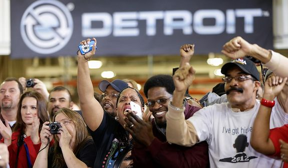 Audience members, including workers, cheer as President Obama speaks Dec. 10, 2012, about the economy during a visit to the Daimler Detroit Diesel plant in Redford, Mich. (Associated Press)