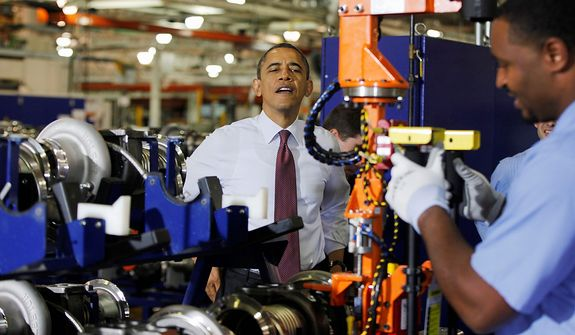 President Obama watches a worker during a Dec. 10, 2012, visit to the heavy duty engines line at the Daimler Detroit Diesel plant in Redford, Mich. (Associated Press)