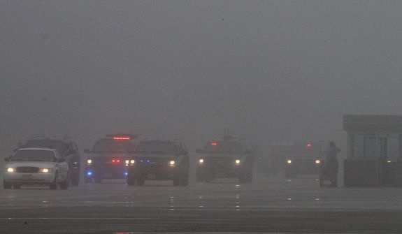 President Obama's motorcade arrives in heavy fog at Andrews Air Force Base in suburban Washington on Monday, Dec. 10, 2012, before Mr. Obama departed for Michigan. (AP Photo/Ann Heisenfelt)