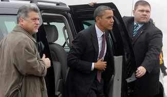 U.S. Secret Service agents hold open the door as President Obama steps out of his vehicle to board Air Force One at Andrews Air Force Base in suburban Washington on Monday, Dec. 10, 2012, as he traveled to Michigan to visit the Daimler Detroit Diesel plant in Redford. (AP Photo/Charles Dharapak)
