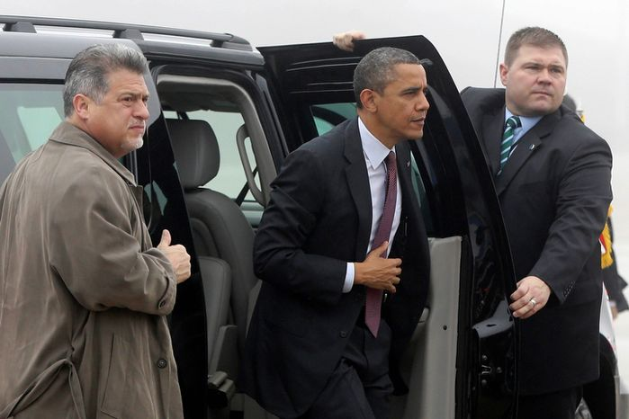 U.S. Secret Service agents hold open the door as President Obama steps out of his vehicle to board Air Force One at Andrews Air Force Base in suburban Washington on Monday, Dec. 10, 2012, as