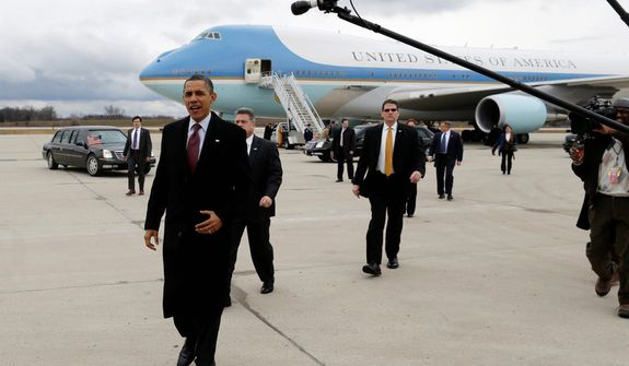 President Obama walks over to greet well-wishers after stepping off Air Force One upon his arrival at  the Detroit Metropolitan Wayne County Airport in Romulus, Mich., on Monday, Dec. 10, 2012, before going to the Daimler Detroit Diesel plant in Redford. (AP Photo/Charles Dharapak)