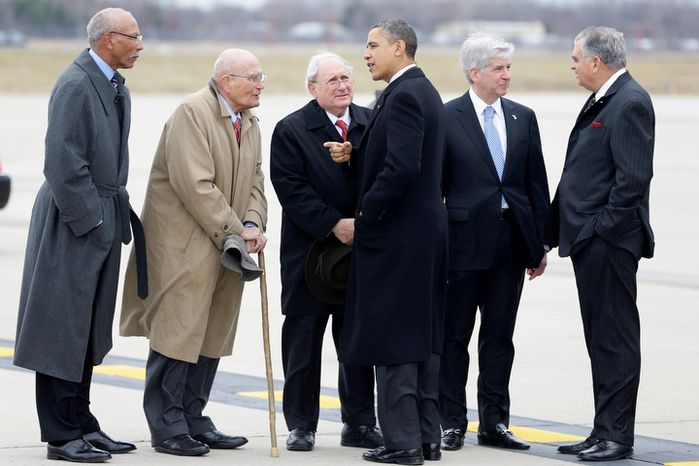 President Obama and Transportation Secretary Ray LaHood (right) are met by (from left) Detroit Mayor Dave Bing, Rep. John D. Dingell, Sen. Carl Levin and Michigan Gov. Rick Snyder after stepping off Air Force One upon arriving at the Detroit Metropolitan Wayne County Airport in Romulus, Mich., on Monday, Dec. 10, 2012, before going to the Daimler Detroit Diesel plant in Redford. (AP Photo/Charles Dharapak)