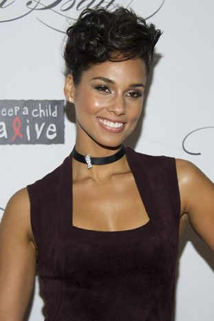 Alicia Keys attends the Keep a Child Alive's ninth annual Black Ball in New York on Thursday, Dec. 6, 2012. (Charles Syk