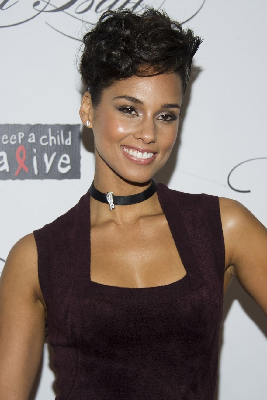 Alicia Keys attends the Keep a Child Alive's ninth annual Black Ball in New York on Thursday, Dec. 6, 2012. (Charles Sykes/Invision/AP)
