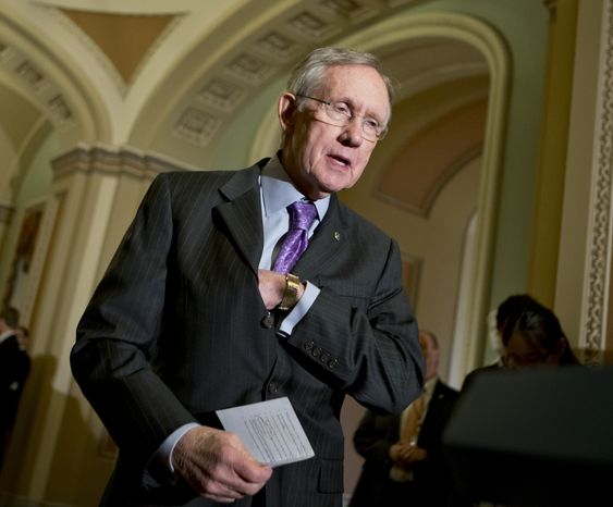 **FILE** Senate Majority Leader Harry Reid, Nevada Democrat, speaks Nov. 27, 2012, with reporters on Capitol Hill in Washington. (Associated Press)