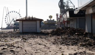 **FILE** Sand and rubble sit Nov. 29, 2012, where the boardwalk used to be in Seaside Heights N.J. Seaside Heights, like many other coastal towns, is racing to rebuild its boardwalk from Superstorm Sandy's damage in time for next summer's tourism season. (Associated Press)