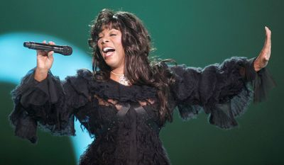 """FILE - This Dec. 11, 2009 file photo shows Donna Summer performing at the Nobel Peace concert in Oslo, Norway. The eclectic group of rockers Rush and Heart, rappers Public Enemy, songwriter Randy Newman, """"Queen of Disco"""" Donna Summer and bluesman Albert King will be inducted into the Rock and Roll Hall of Fame next April in Los Angeles. The inductees were announced Tuesday by 2012 inductee Flea of The Red Hot Chili Peppers at a news conference in Los Angeles. (AP Photo/John McConnico, file)"""