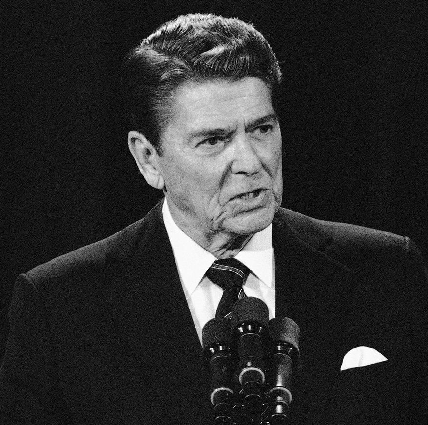 Ronald Reagan inspired many Americans with his phrase for foreign policy. Two groups are now claiming it as their own. (Associated Press)