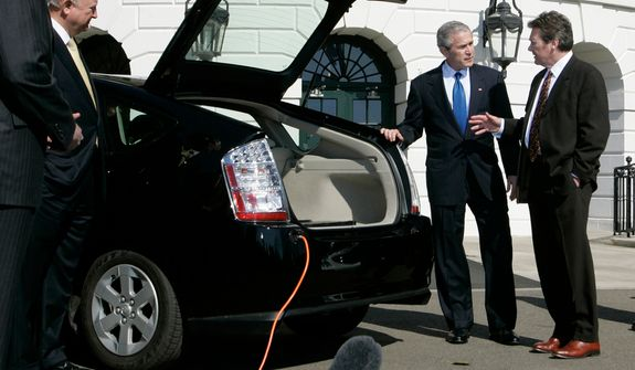 **FILE** President Bush (center) listens to Dave Vieau (right), president and CEO of A123 Systems, as he is shown a Toyota Prius plug-in hybrid car utilizing a lithium power battery during a demonstration of alternative fuel automobiles on the South Lawn of the White House in Washington on Feb. 23, 2007. At left is Energy Secretary Sam Bodman. (Associated Press)