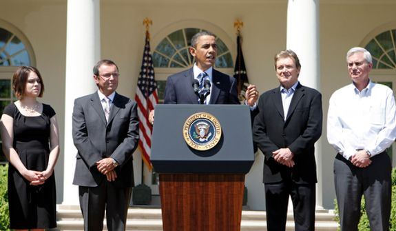 **FILE** President Obama, accompanied by business people, speaks in the Rose Garden of the White House in Washington on April 30, 2010. (Associated Press)