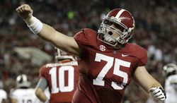 Alabama offensive lineman Barrett Jones (75) reacts after a Crimson Tide score during the first half of an NCAA college football game against Mississippi State at Bryant-Denny Stadium in Tuscaloosa, Ala., Saturday, Oct. 27, 2012. (AP Photo/Dave Martin)
