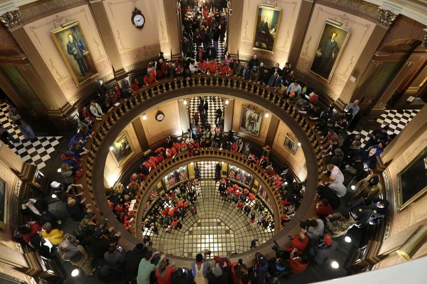 Protesters gather for a rally in the Capitol Rotunda in Lansing, Mich., on Tuesday, Dec. 11, 2012. The crowd is demonstrating against legislation that could make Michigan the 24th state with a right-to-work law. (AP Photo/Paul Sancya)