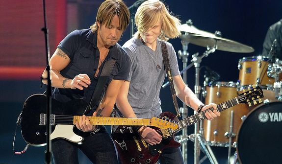 Keith Urban and the Grammy Camp Band perform during the American Country Awards on Monday, Dec. 10, 2012, in Las Vegas. (Al Powers/Powers Imagery/Invision/AP)
