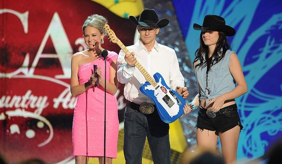 Jewel and Ty Murray appear onstage during the American Country Awards on Monday, Dec. 10, 2012, in Las Vegas. (Al Powers/Powers Imagery/Invision/AP)