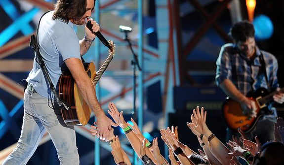Jake Owen performs during the American Country Awards on Monday, Dec. 10, 2012, in Las Vegas. (Al Powers/Powers Imagery/Invision/AP)