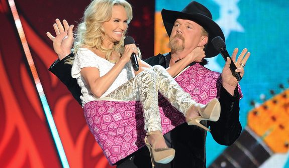 Kristin Chenoweth and Trace Adkins perform during the American Country Awards on Monday, Dec. 10, 2012, in Las Vegas. (Al Powers/Powers Imagery/Invision/AP)