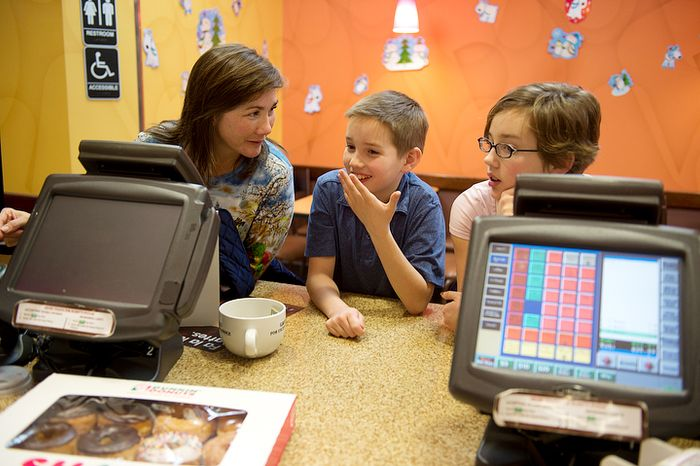 Wil Hiday, center, confers with mom Kim and sister Chase, 15, as they pick out donuts after school at Dunkin' Donuts on Tuesday, Dec. 11, 2012 in Vienna, Va. Wil is going to bring the donuts to school Wednesday, when he turns 12 years old on 12/12/12. Tonight the family is going to celebrate at IHOP at the stroke of midnight. (Barbara L. Salisbury/The Washington Times)