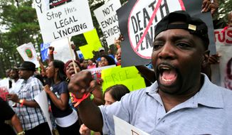 **FILE** Demonstrators chant slogans against the death penalty at a Sept. 21, 2011, rally in Jackson, Ga., for Georgia death row inmate Troy Davis, who was executed later that day for the 1991 murder of a police officer. (Associated Press)