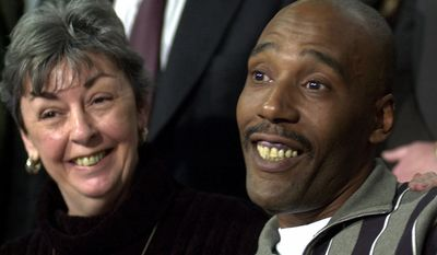 **FILE** Former death row inmate Earl Washington Jr. smiles during a Feb. 12, 2001, news conference in Virginia Beach, Va., as Marie Deans, a member of his legal team, listens. Washington was released from prison thanks to DNA tests showing he was wrongly convicted in the 1982 rape and slaying of Rebecca Lynn Williams. (Associated Press)