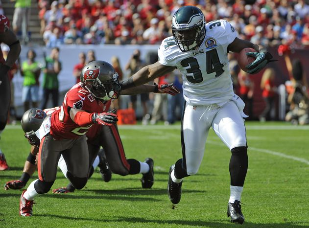 Philadelphia Eagles running back Bryce Brown (34) stiff arms Tampa Bay Buccaneers defensive back Anthony Gaitor (26) during the first quarter of an NFL football game Sunday, Dec. 9, 2012, in Tampa, Fla. (AP Photo/Brian Blanco)
