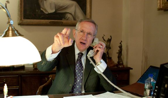 Senate Majority Leader Harry Reid, Nevada Democrat, gestures as he takes a call in his office before the jobs bill cloture vote on Capitol Hill in Washington on Monday, Feb. 22, 2010. A bipartisan jobs bill cleared a GOP filibuster with critical momentum provided by the Senate's newest Republican, Sen. Scott P. Brown of Massachusetts. (AP Photo/Harry Hamburg)