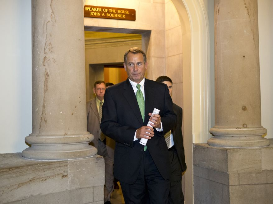 """House Speaker John Boehner, Ohio Republican, leaves his office Dec. 11, 2012, and walks to the House floor on Capitol Hill in Washington to deliver remarks about negotiations with President Obama on the """"fiscal cliff."""" (Associated Press)"""