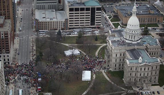Protesters to the right-to-work legislation march on the state Capitol in Lansing, Mich., on Tuesday Dec. 11, 2012. Several thousand union members gathered to protest the legislation. (AP Photo/Detroit Free Press, Romain Blanquart)