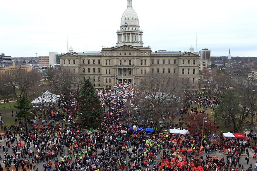 Thousands of supporters rally at the State Capitol grounds in Lansing, Mich., Tuesday, Dec. 11, 2012. The crowd is protesting right-to-work legislation that was passed by the state legislature last week. (AP Photo/Carlos Osorio)