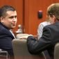 ** FILE ** George Zimmerman (left) talks with defense counsel Mark O'Mara during a court hearing at the Seminole County Courthouse on Tuesday, Dec. 11, 2012, in Sanford, Fla. (AP Photo/Orlando Sentinel, Joe Burbank, Pool)