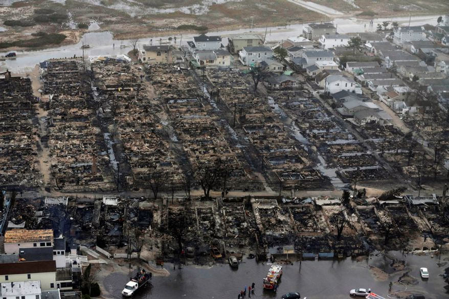 This Tuesday, Oct. 30, 2012, aerial photo shows burned-out homes in the Breezy Point section of the Queens borough in New York. The tiny beachfront neighborhood was told to evacuate before superstorm Sandy hit New York and burned down as it was inundated by floodwaters, transforming a quaint corner of the Rockaways into a smoke-filled debris field. (AP Photo/Mike Groll)