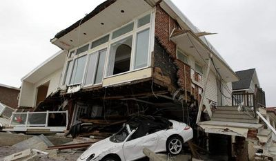 In this Nov. 19, 2012 file photo, a beachside house, deemed uninhabitable by the New York City Department of Buildings, is left in ruins in the Belle Harbor neighborhood of the Rockaways, in New York. (AP Photo/Kathy Willens, File)