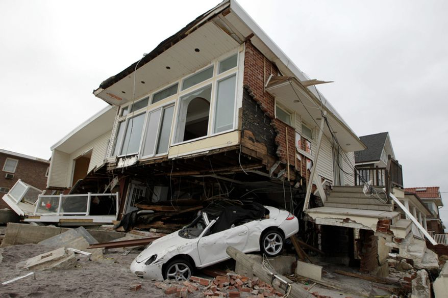 A beachside house deemed uninhabitable by the New York City Department of Buildings is left in ruins in the Belle Harbor neighborhood of the Rockaways in New York on Monday, Nov. 19, 2012. (AP Photo/Kathy Willens)