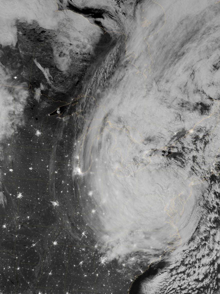 This image provided by NASA shows the Eastern Seaboard of the United States at night from a composite assembled from data acquired by the Suomi NPP satellite as Hurricane Sandy came ashore on Tuesday, Oct. 30, 2012. The Visible Infrared Imaging Radiometer Suite (VIIRS) on the Suomi NPP satellite acquired this image of the storm at 3:35 a.m. EDT. (AP Photo/NASA)