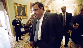 ** FILE ** New Jersey Gov. Chris Christie walks to a meeting on Capitol Hill in Washington on Thursday, Dec. 6, 2012, to talk about aid to help his state recover from superstorm Sandy. President Obama is expected to ask Congress for about $50 billion in additional emergency assistance. (AP Photo/J. Scott Applewhite)